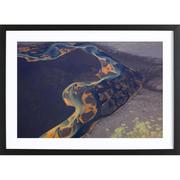 Bild 'Color patterns of river on sand'