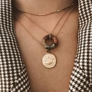 Längeres 'Dream Baby'-Perlenkettchen mit Anhänger