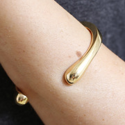 Armreif 'Spark Cuff' in gold
