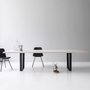 Lowlight table from side with deco steel copilot chair 2